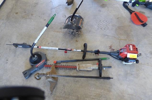Craftsman Weedeater with cultivator, blower, saw, hedge trimmer