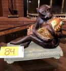 Decorative Monkey, Hugging a Goldfish