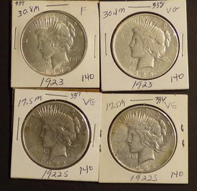2 1922-S and 2 1923 Peace Silver Dollars
