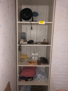 Contents of Shelves including Fan, phone, blankets, clock and more