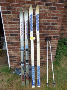 2 sets of Rossingnol Snow Skis and set of poles