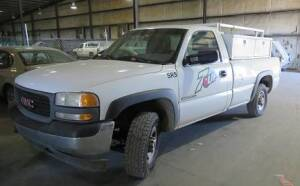 2002 GMC 2500  (441,822) miles, tommy lift, custom rack and tool boxes ( runs and drives, needs rear end repair)