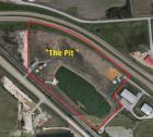20.86 Acres m/l with metal buildings and lake, located I-555 -