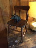 small wooden childs chair and pig