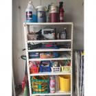 Adjustable Plastic Shelf w/ Lots of Garage Goodies- Water Hose, Battery Charger, Floodlight, Air Pumps, Oil, Coolers, Fire Extinguisher, & More!